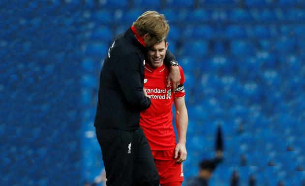 Jurgen Klopp hugs James Milner after the game at City