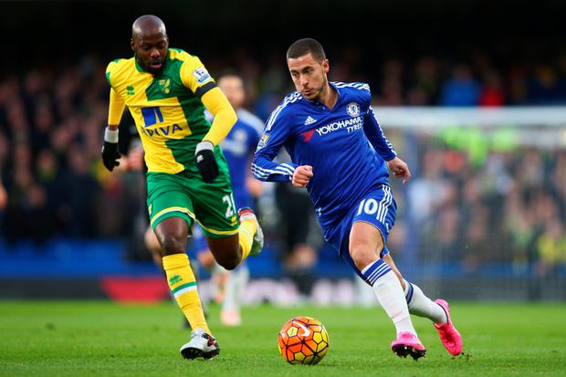 Eden Hazard gets past Norwich's Youssouf Mulumbu during the clash at Stamford Bridge