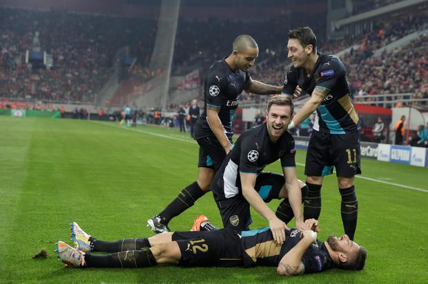 Theo Walcott, Mesut Ozil and Aaron Ramsey congratulate goalscorer Olivier Giroud during the win over Olympiacos
