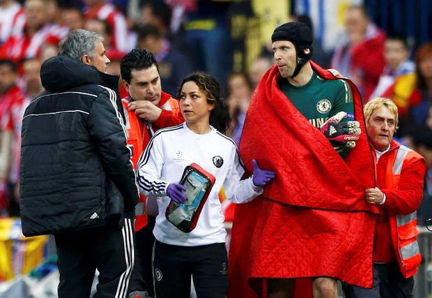 In the previous season, Carneiro and goalkeeper Petr Cech talk to Jose Mourinho during their Champion's League semi-final first leg against Atletico Madrid