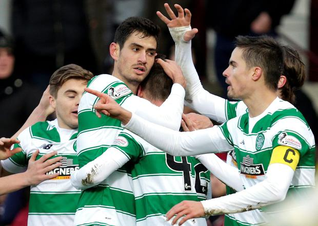 Celtic's Nir Bitton (c) celebrates scoring their first goal with team-mates Photo:Reuters