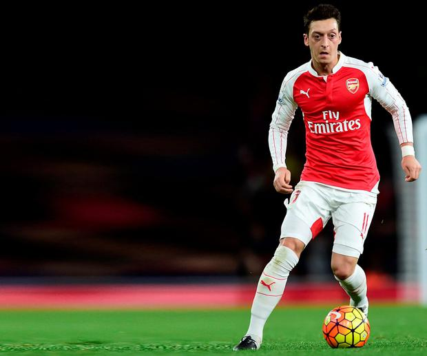 Mesut Ozil ha been at the forefront of Arsenal's rise to the top of the Premier League table Photo:PA
