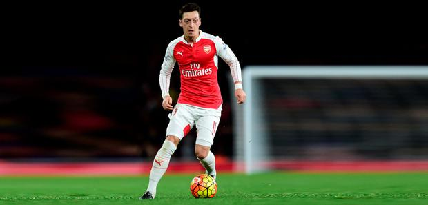 Arsenal manager Arsene Wenger says he is getting the best out of Mesut Ozil by resting him between matches Photo:PA