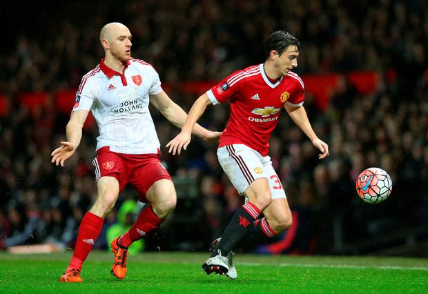 Sheffield United's Irish striker Conor Sammon challenges Manchester United's Matteo Darmian during the FA Cup third round tie at Old Trafford last Saturday.