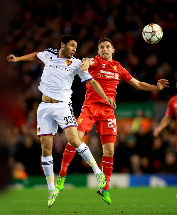 Mohamed Elneny (left) in action for Basel against Liverpool's Joe Allen (PA)