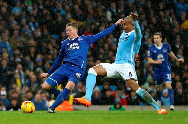 Everton's James McCarthy has a shot on goal under pressure from Manchester City's Fernando during the League Cup semi final. Photo: PA