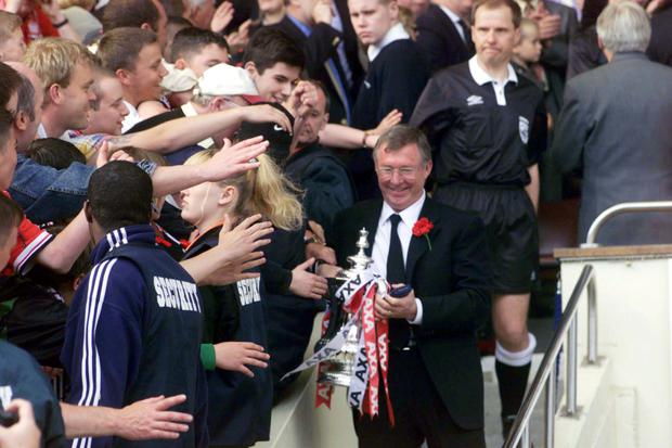Manchester United manager Alex Ferguson with the FA Cup back in May 1999: Sean Dempsey / PA