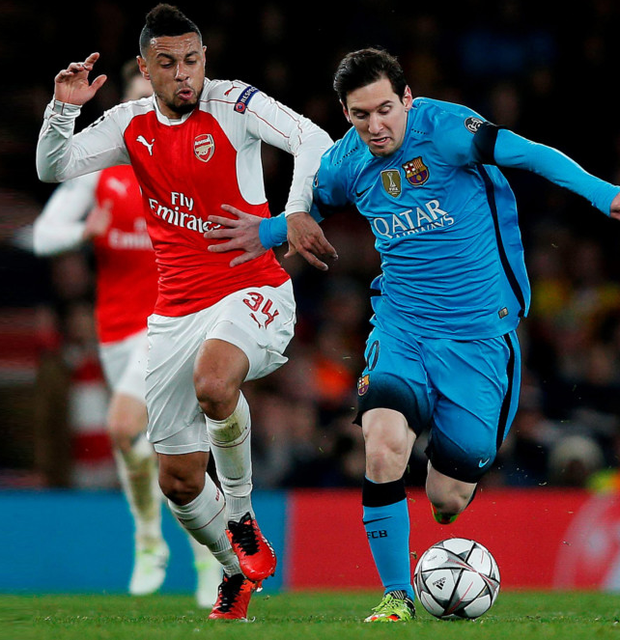 Arsenal's Francis Coquelin tries to shackle Barcelona forward Lionel Messi during their Champions League first leg clash at the Emirates Stadium, London