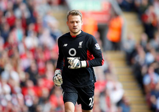 Goalkeeper Simon Mignolet could be on his way out of Anfield : PA Wire