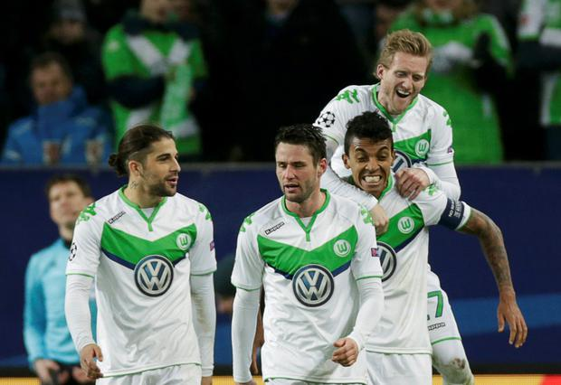 Wolfsburg players celebrate as they see off Gent at the Volkswagen Arena