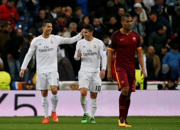 Cristiano Ronaldo and James Rodriguez celebrate in the win over Roma