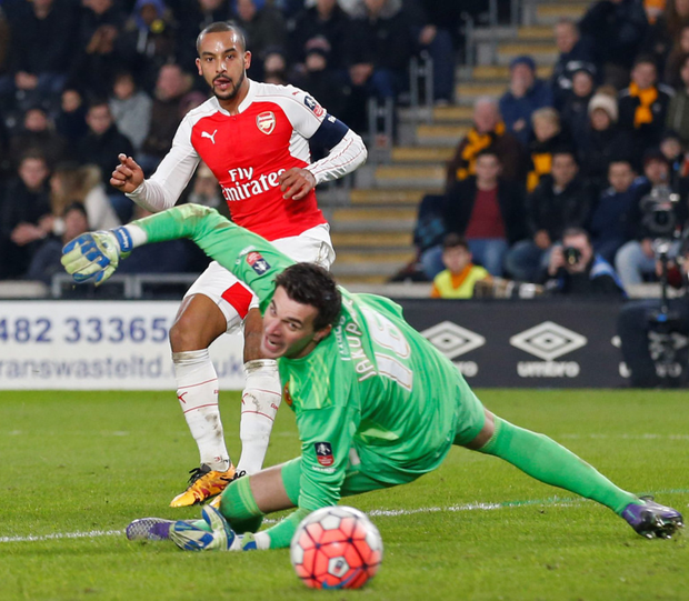 Theo Walcott scores the third goal for Arsenal in the FA Cup fifth round replay win over Hull City on Tuesday night Photo: Reuters