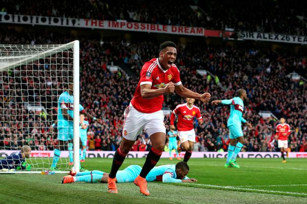 Anthony Martial celebrates his equalising goal which forced a replay for Manchester United in their FA Cup quarter-final clash against West Ham Photo: PA