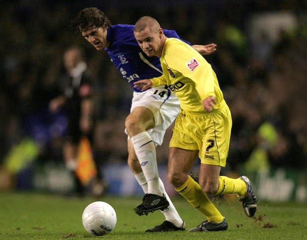 Millwall's Alan Dunne (right) battles with Everton's Kevin Kilbaneduring the FA Cup third round replay at Goodison Park in 2008.,