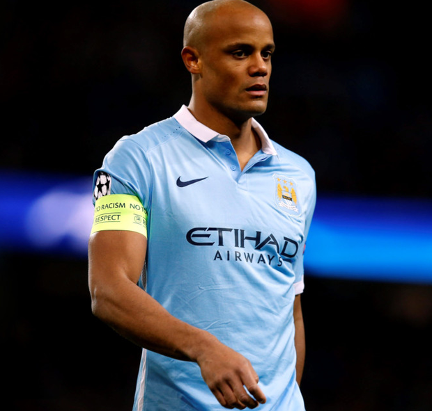 Manchester City's Vincent Kompany leaves the field after picking up an injury during the Champions League match at the Etihad Stadium last night.