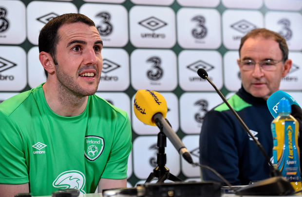 Republic of Ireland's John O'Shea with manager Martin O'Neill during a press conference at the Aviva Stadium yesterday.