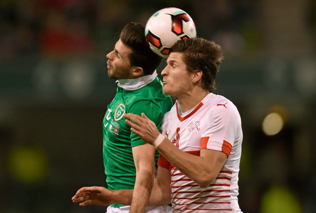 Shane Long goes for a header against Swiss defender Timm Klose