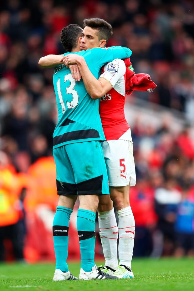 Arsenal's Gabriel (right)