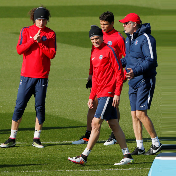 Paris St Germain's coach Laurent Blanc (right) with Edinson Cavani and Thiago Motta at a training session on the eve of their UEFA Champions League clash against Manchester City.