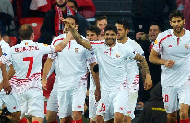 Sevilla players celebrate after scoring against Athletic Bilbao last night Photo: Reuters