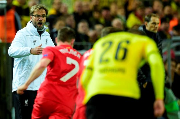 Jurgen Klopp issues instructions during last night's game Photo: AFP/Getty