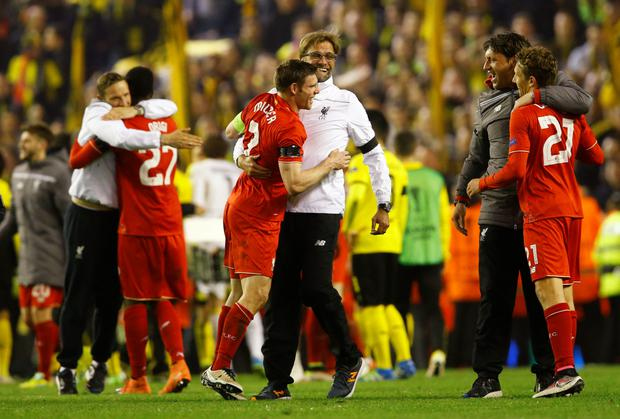 Milner and Klopp (centre) Photo: Reuters