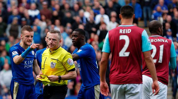 Leicester City's Jamie Vardy (left) reacts after his red card from referee Jonathan Moss (centre). Photo: Getty