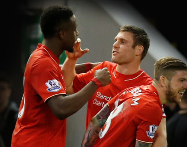 James Milner and Alberto Moreno congratulate Divock Origi on opening the scoring in last night's win over Everton