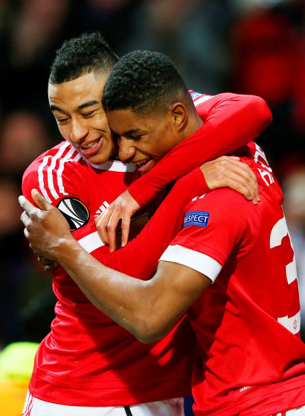 Jesse Lingard congratulates his Manchester United team-mate Marcus Rashford on his debut goal against Midtjylland in February Photo: Getty