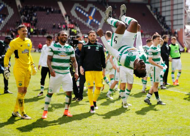 Celtic players celebrate the Scottish Premiership win over Hearts at Tynecastle on Saturday.