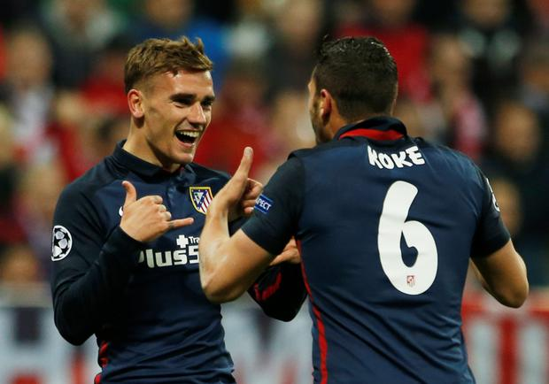 Antoine Griezmann (l) celebrates scoring for Atletico Madrid with team-mate Koke (Reuters)