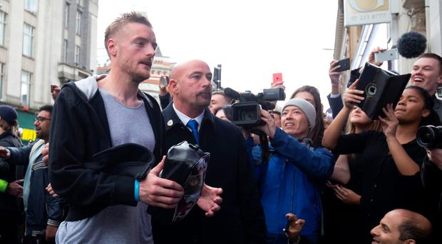 Leicester City striker Jamie Vardy is cheered by crowds of waiting fans as he arrives for lunch with the rest of the Foxes squad in the centre of Leicester yesterday (Getty)