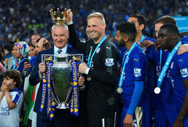 Leicester City manager Claudio Ranieri and goalkeeper Kasper Schmeichel celebrate winning the Premier League title at the King Power Stadium last Saturday. Photo: Getty