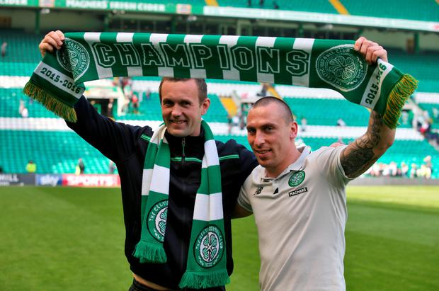 Celtic manager Ronny Deila (left) and captain Scott Brown celebrate winning the Scottish Premiership after beating Aberdeen at Celtic Park yesterday. Photo: PA