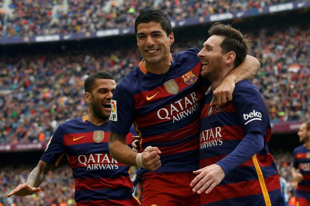 (l-r) Suarez and Messi. Photo: Reuters