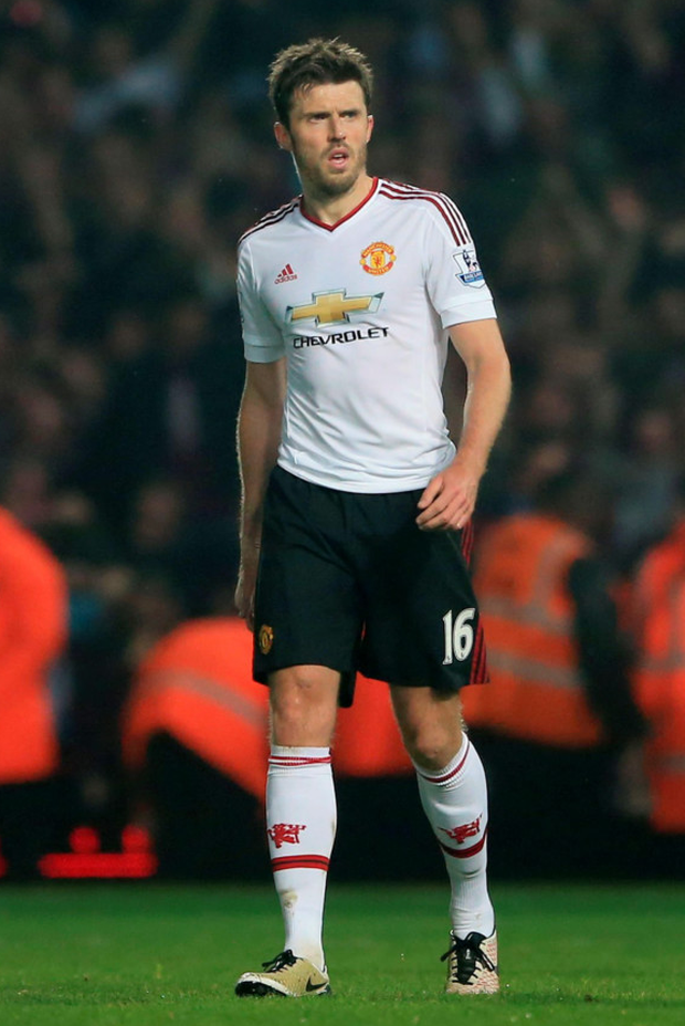 Manchester United midfielder Michael Carrick cuts a dejected figure after Tuesday night's defeat to West Ham at Upton Park. Photo: Nick Potts/PA Wire