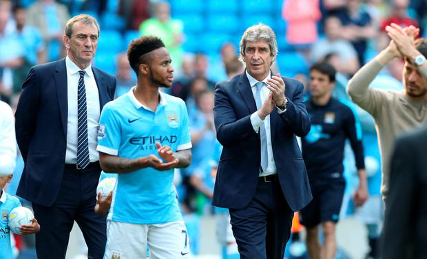 Manuel Pellegrini and Raheem Sterling applaud the Man City fans