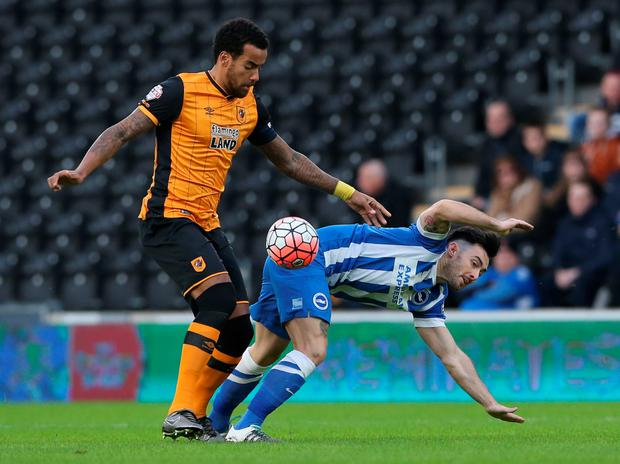 Hull's Tom Huddlestone challenges Brighton & Hove Albion's Richie Towell
