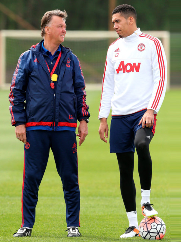 Manchester United manager Louis van Gaal with Chris Smalling, during a training session at the Aon Training Complex in Carrington, ahead of their FA Cup final clash with Crystal Palace at Wembley tomorrow. Photo: Martin Rickett/PA Wire