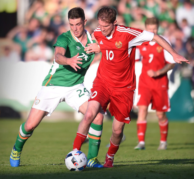 Republic of Ireland's Ciarán Clark in action with Belarus' Alexander Hleb during their friendly at Turner's Cross, Cork last night. Photo: Reuters