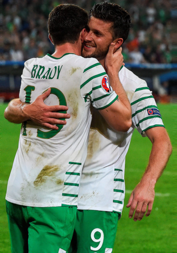 Shane Long embraces goalscorer Robbie Brady. Photo: David Maher/Sportsfile