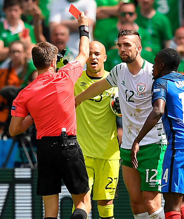 Shane Duffy is shown a red card by referee Nicola Rizzoli. Photo: Stephen McCarthy/Sportsfile