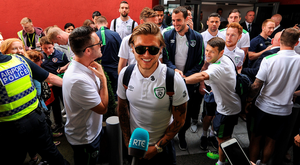 A smiling Jeff Hendrick as the Republic of Ireland team arrive back in Dublin. Pic: Sportsfile