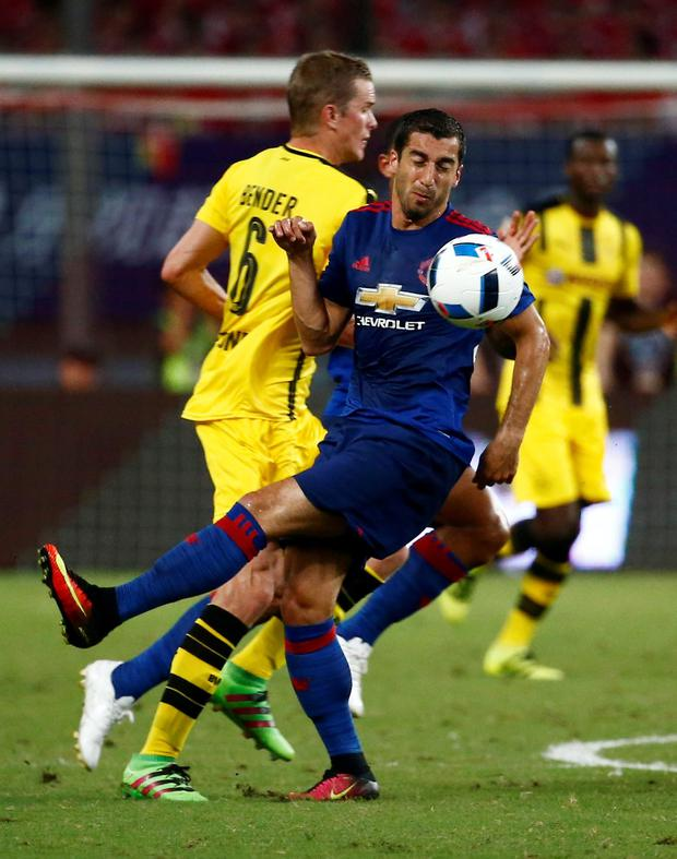 Manchester United's Henrikh Mkhitaryan clashes with his former Borussia Dortmund team-mate Sven Bender. Photo: Reuters