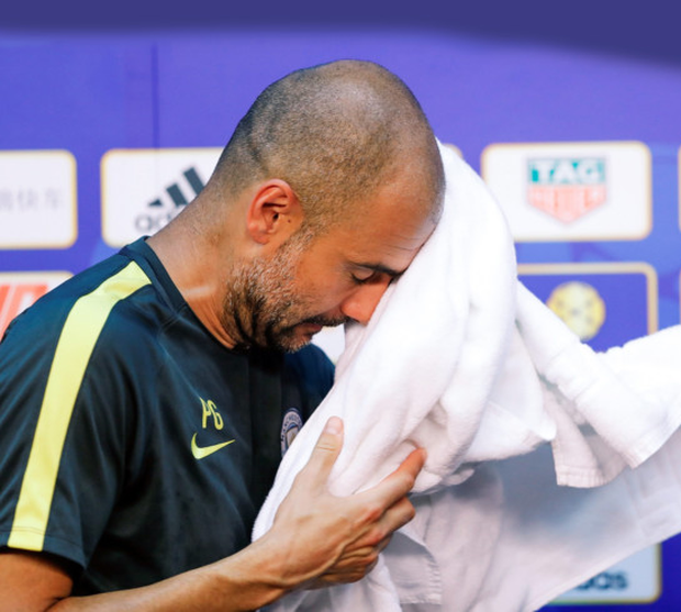 Manchester City boss Pep Guardiola feels the heat at his press conference in Beijing