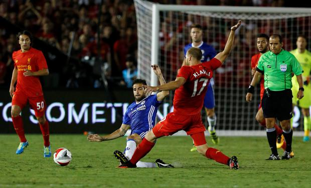Fabregas' challenge on new Liverpool recruit Klavan. Photo: Reuters