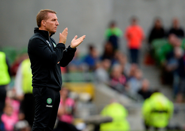 Celtic manager Brendan Rodgers applauds his team during the friendly defeat to Barcelona on Saturday.