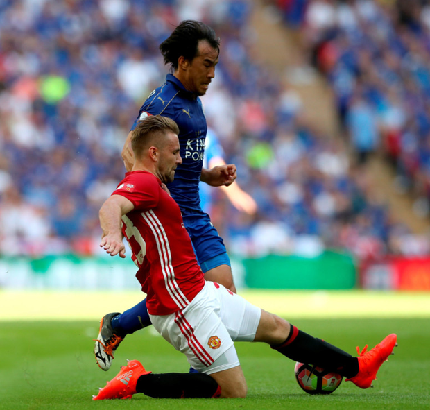 Leicester City's Shinji Okazaki (top) and Manchester United's Luke Shaw battle for the ball during the Community Shield match at Wembley. Photo: PA