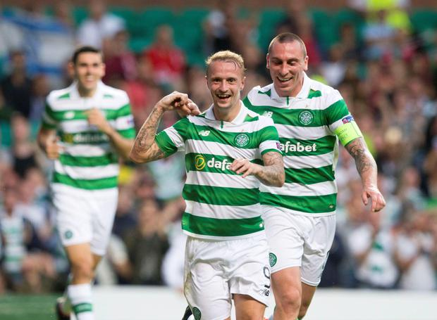 Celtic's Leigh Griffiths celebrates scoring his side's third goal of the game with team-mate Scott Brown during the UEFA Champions League qualifying play-off, first leg match against Hapoel Be'er Sheva at Celtic Park