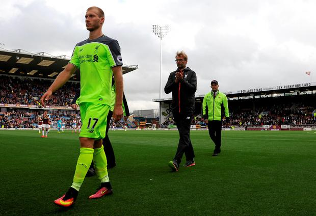 Liverpool defender Ragnar Klavan and manager Jurgen Klopp walk off the pitch at the end of Saturday's Premier League defeat to Burnley.